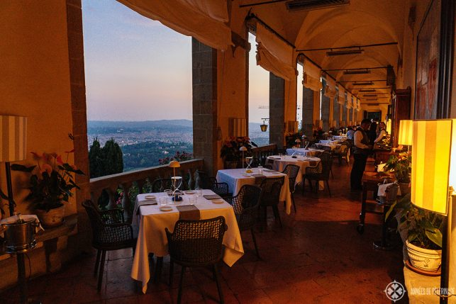 The Loggia Restaurant at Belmond Villa San Michele set up for dinner