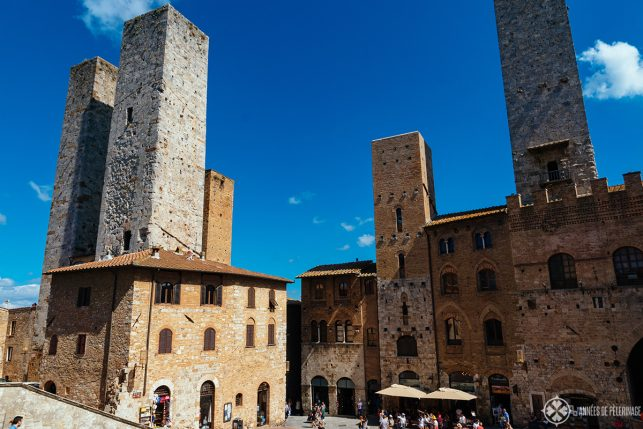 Medieval towers on the main square of San gimignano - one of the top tourist attractions in Tuscany