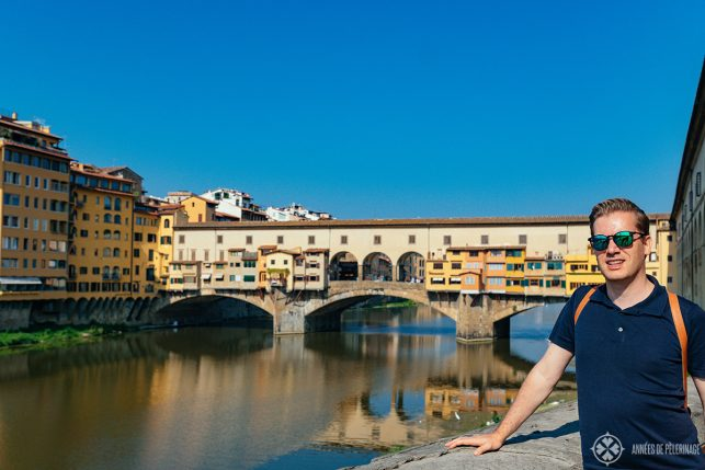 Me, in front of the Ponte Vecchio in Florence - if you are wondering what to pack for Italy in September, then think mild summer wear.