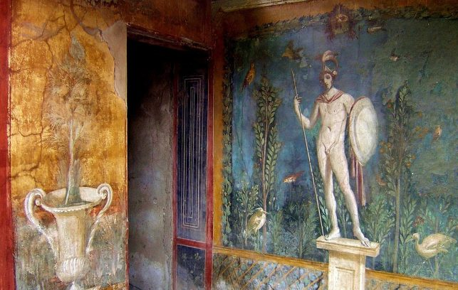 One of many ancient Roman frescoes in Pompeii - one of the best places to see in Italy