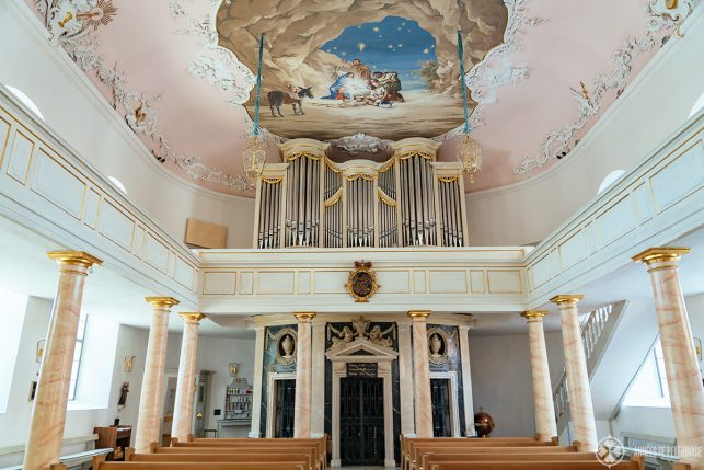 The tomb of Margravine Wilhelmine and her husband Friedrich III.  (below the organ) inside the Schlosskirche in Bayreuth
