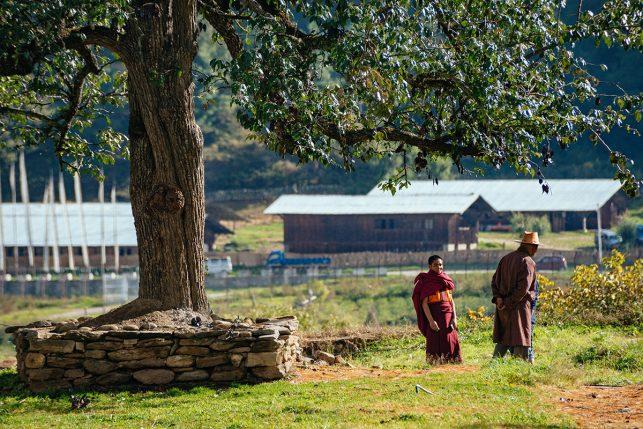 A bhutanese monk greeting a stranger