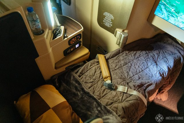 The business class seat of ethiad airways transformed into a bed at night