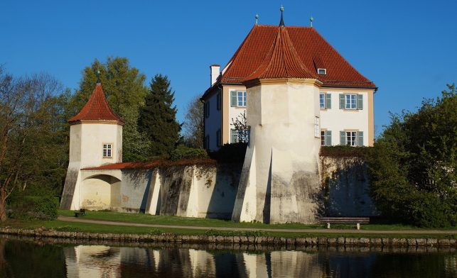 Blutenburg castle with a big water moat around it