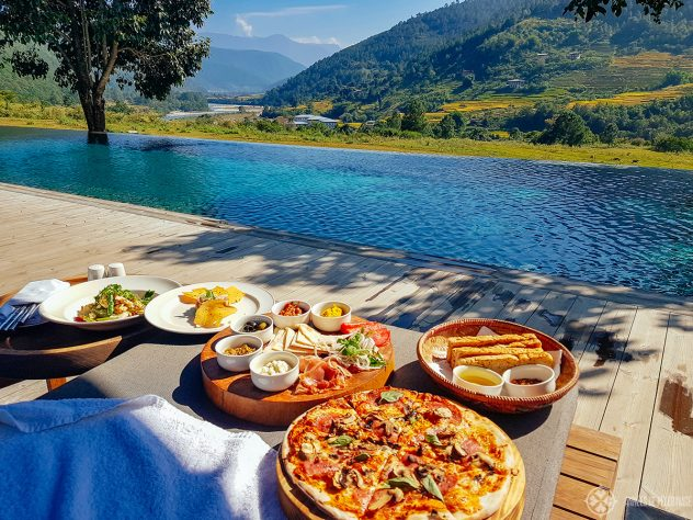 Enjoying some snacks by the poolside in Punakha