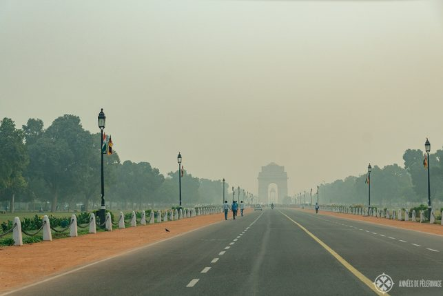 The India Gate as seen from the Parliament (very far away) in Delhi, India