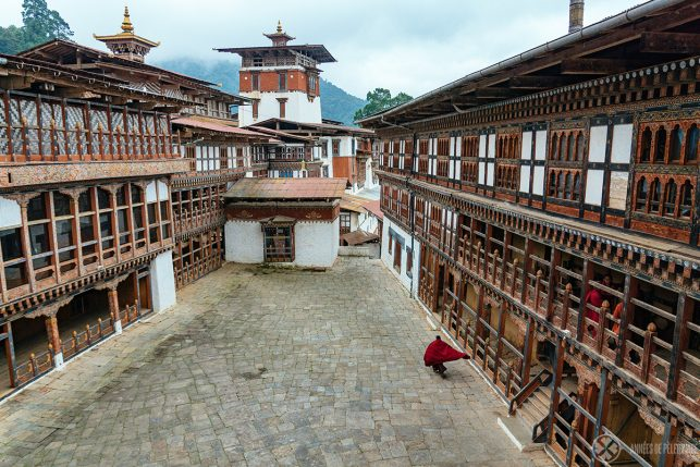 A monk walking inside Trongsa Dzong - Bhutan's longest dzong