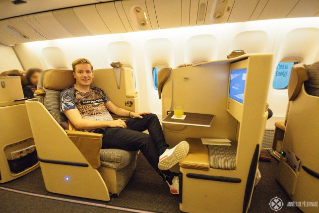 me sitting in the business class of etihad airways