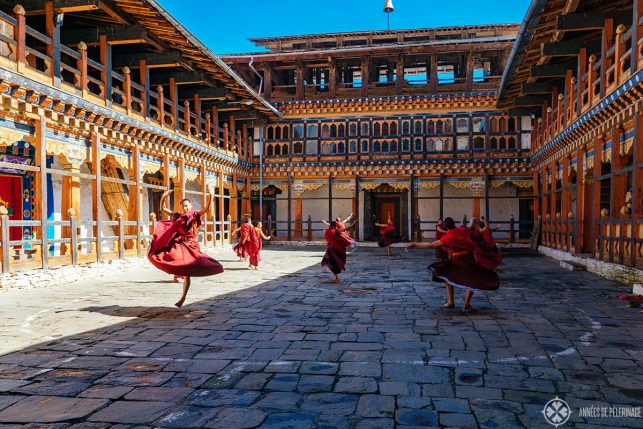 A couple of monks practicing for an upcoming festival in Bumthang