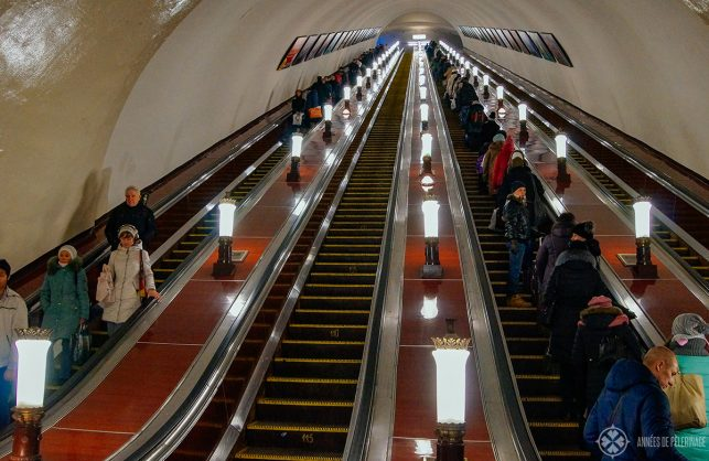 The Moscow subway is quite deep down below. On the picture you can see a very long escalator.