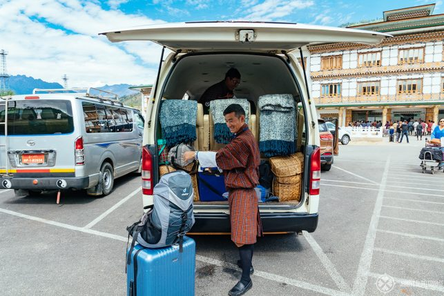 Our guides loading our luggage into the van