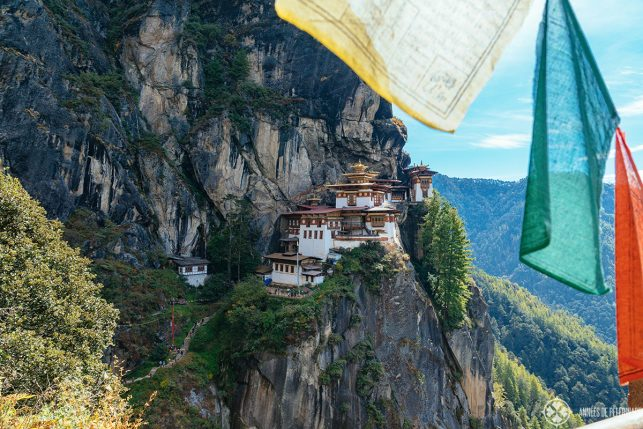 The Tiger's Nest with prayer flags in the foreground - after a long hike of 2 hours from Paro valley in Bhutan