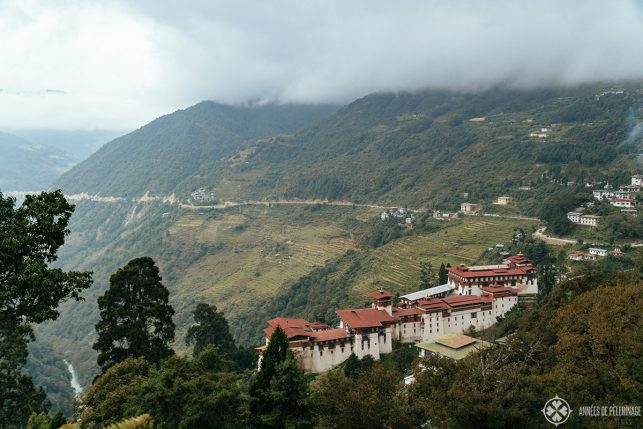 View of Trongsa Dzong from above on a cloudy day in Bhutan