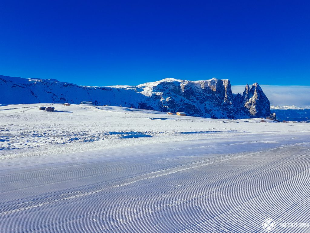 Pristine ski slopes early in the morning at the Alpe Di Suisi in Italy