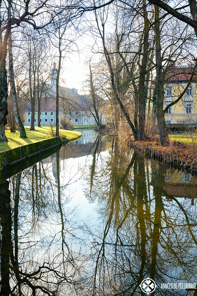 A water channel flowing around fürstenfeld abbey near munich