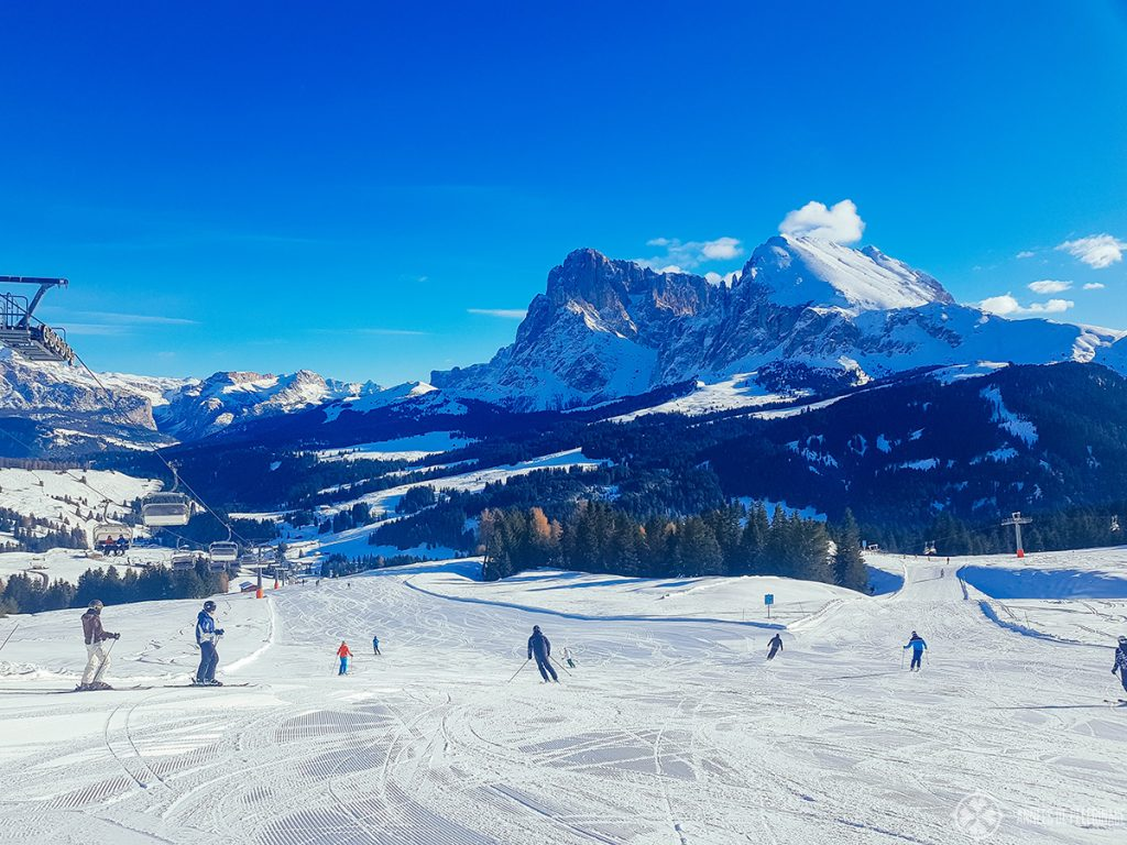 Slopes with the famous Sassoplatto and Sassolungo mountains in the background in the Italian Dolomites