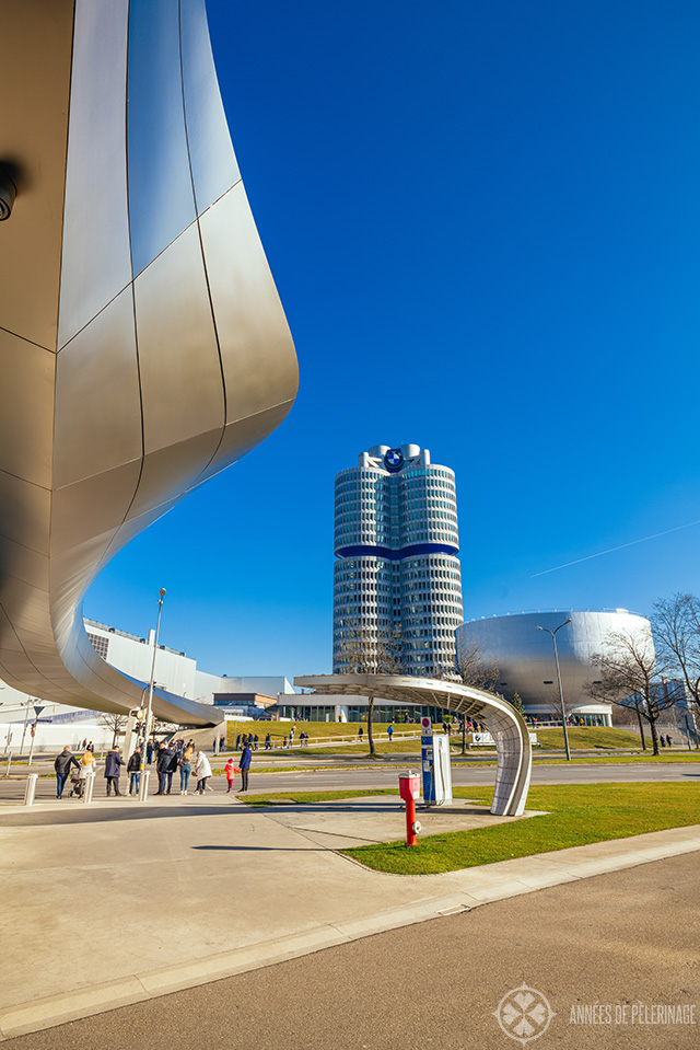 The BMW World in Munich with the BWM towers and museum in the background on a warm day in January