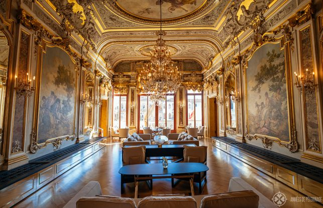The restaurant of the Aman Venice luxury hotel with golden stucco and paintings all over