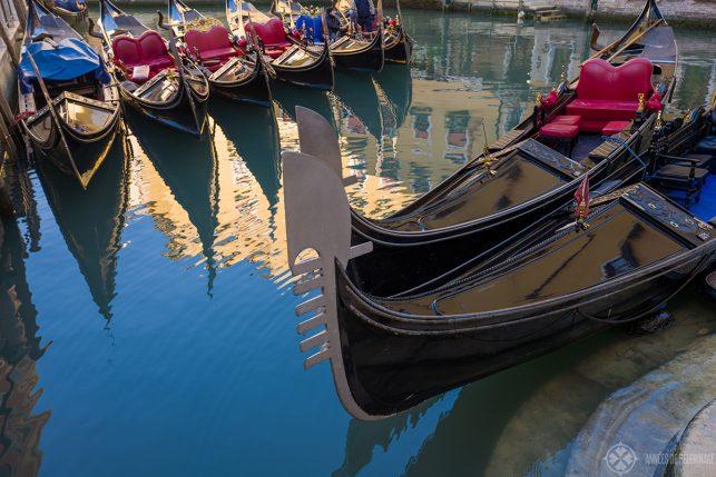 A couple of gondolas in little harbor in Venice