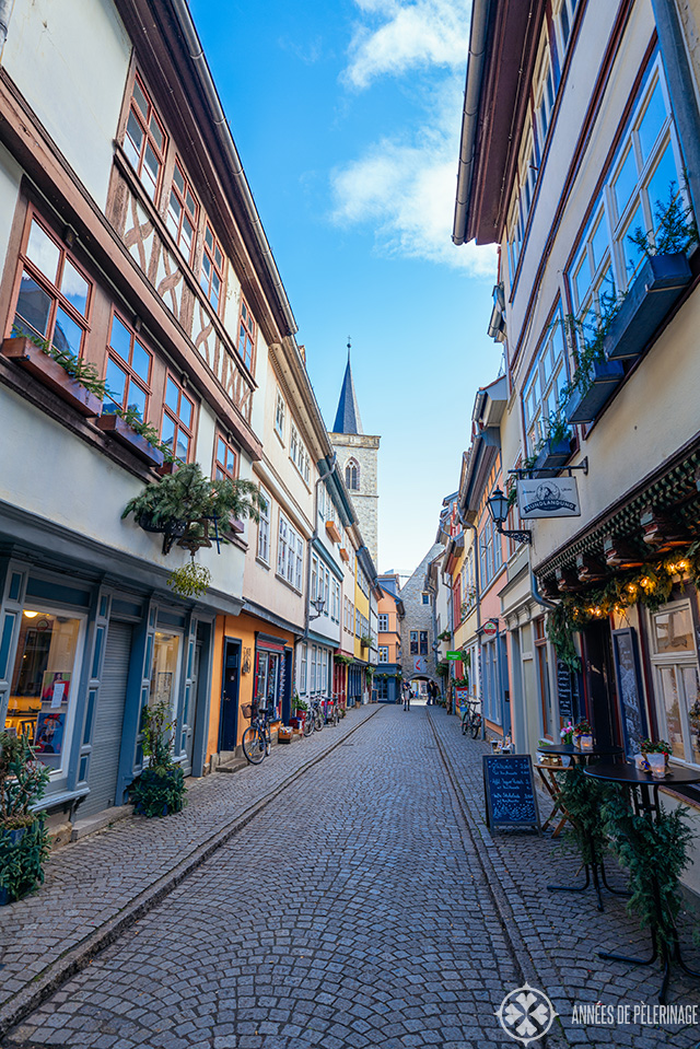 Half-timbered houses lining the cobblestone street of the Krämerbrücke bridge