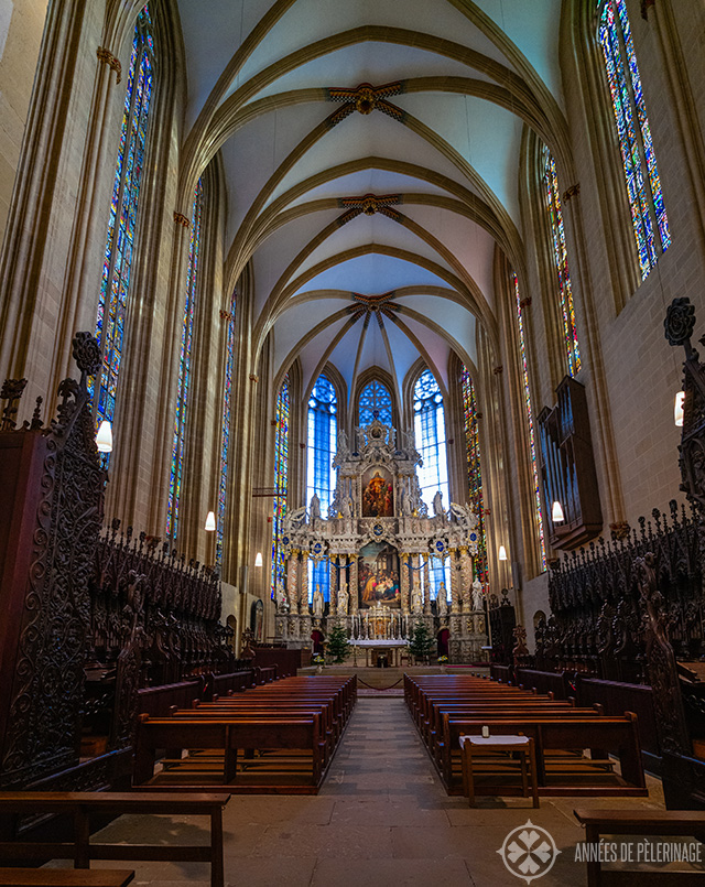 Inside Erfurt Cathedral with the medieval choir stalls and stained-glass windows