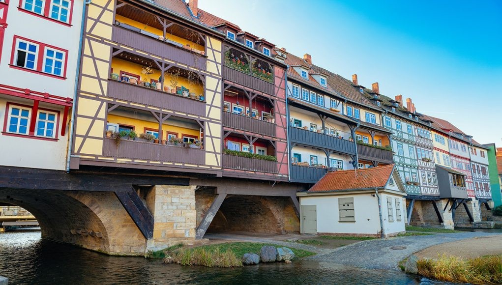 THe fantastic krämerbrücke with colorful half-timbered houses lining the lenght of the bridge in Erfurt