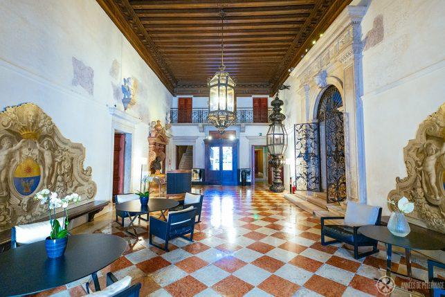 The historic lobby on the ground floor of Aman Venice