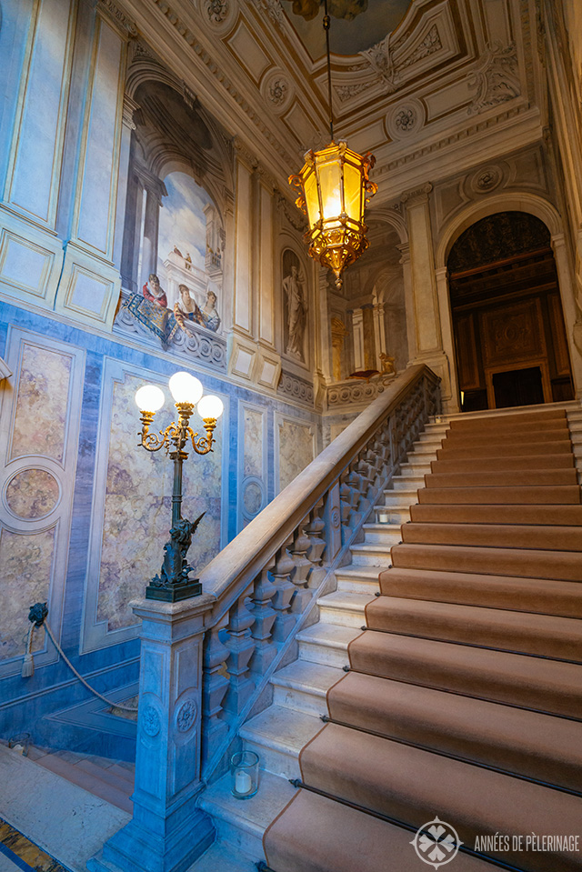The beautiful main stair case with frescos and beautiful marble inlays and a huge lamp