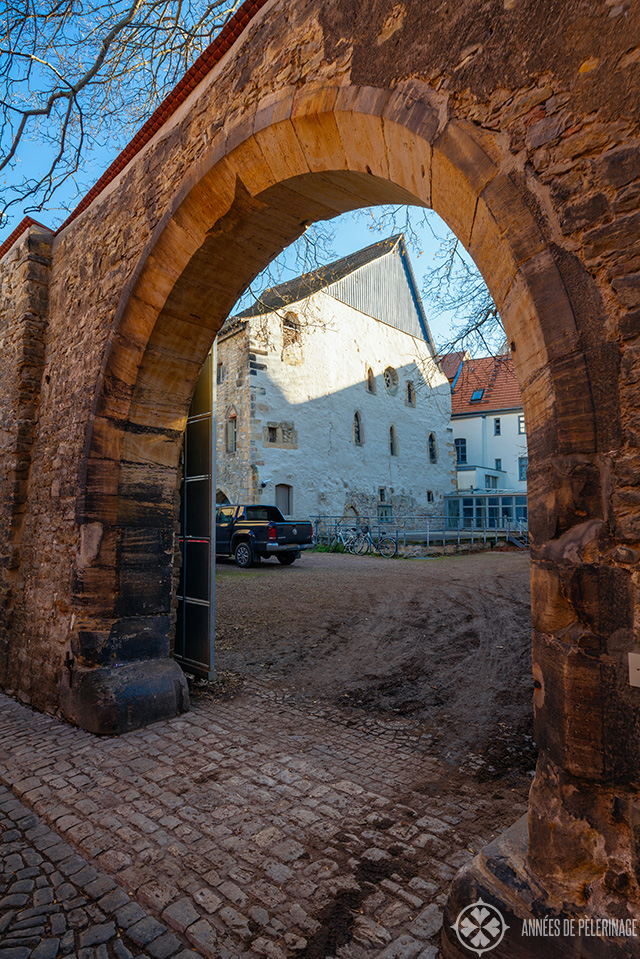 Erfurt's old synagogue as seen through a stone gate