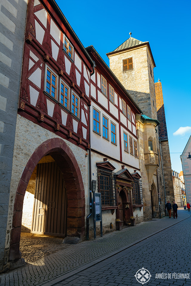 The old town of Erfurt with a medieval tower in the background