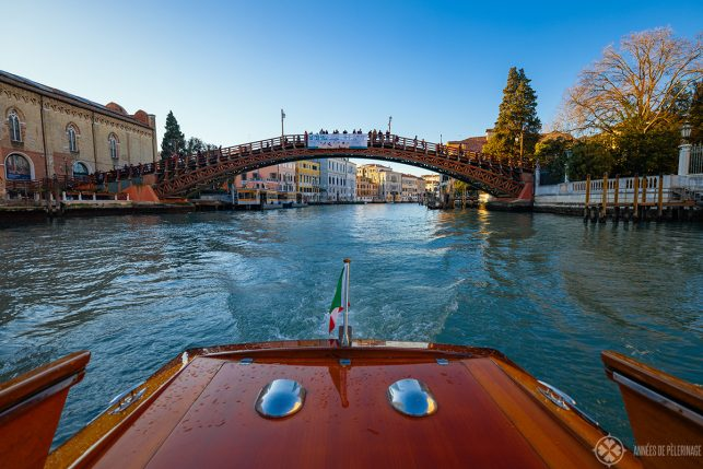 First person view of a boat driving through the Ponte dell'Accademia in Venice