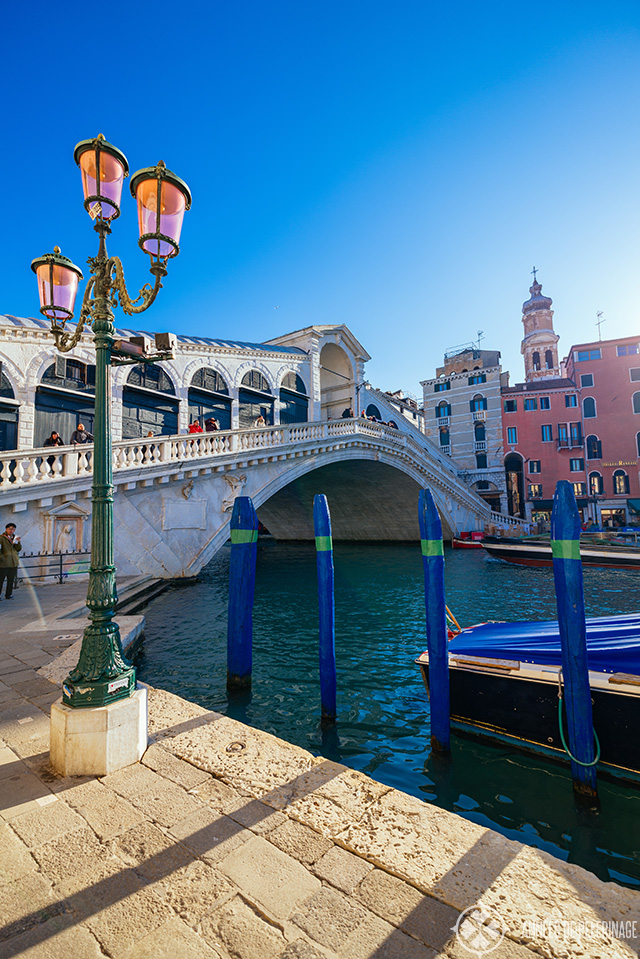 The Rialto bridge with a typical Venetian street lantern in the foreground on a particular sunny day in February