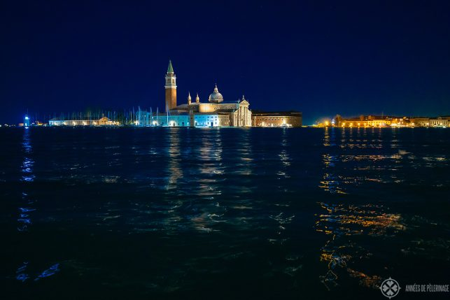 San Giorgio Maggiore at night with the golden lights reflecting in the water
