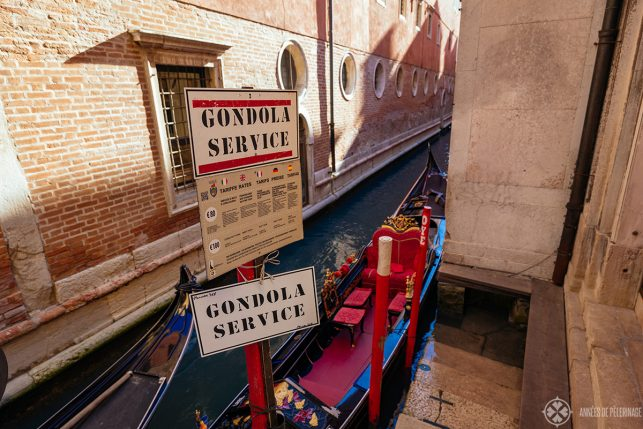 A sign advertising a Gondola Service in Venice Italy