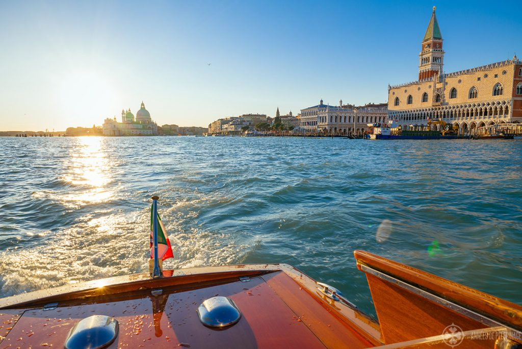 View of Doge Palace and the Venice water front from the back of a water taxi