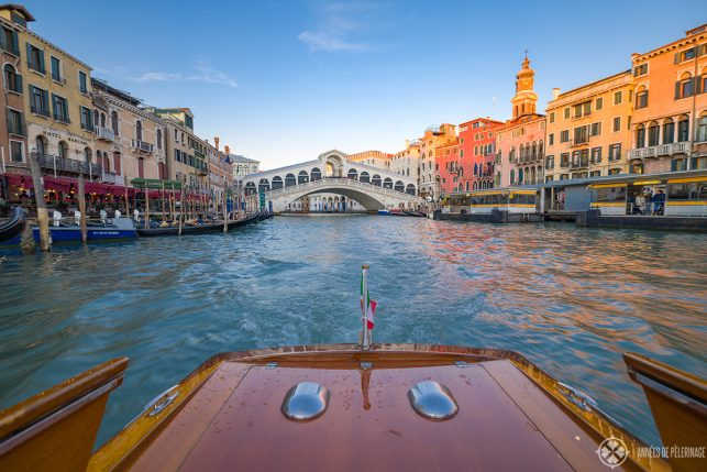 View of the Rialto bridge from a water taxi in venice