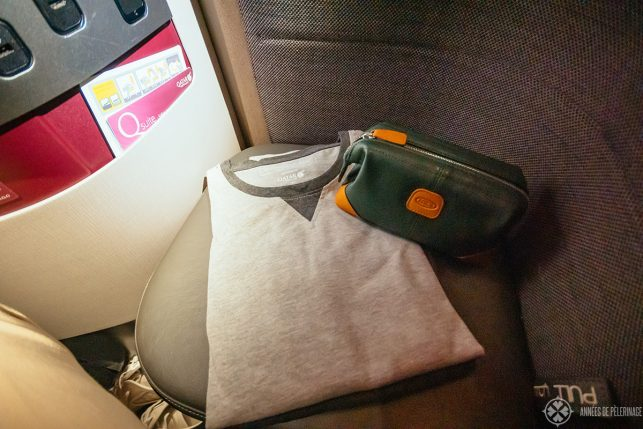 a typical business class amenity kit and pjama