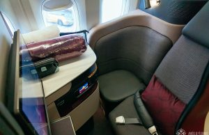 a business class seat of Qatar airways