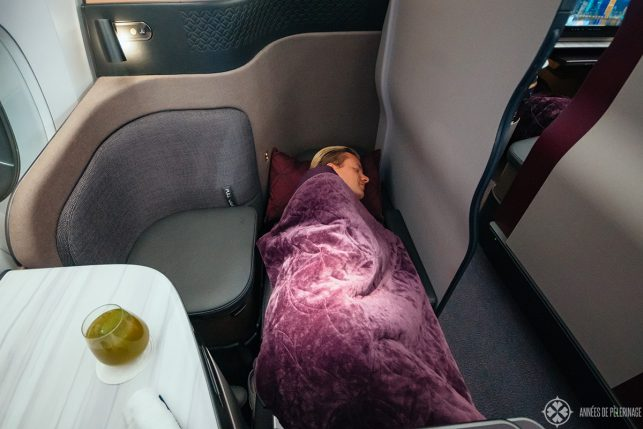 Me sleeping in the qsuites of qatar airways business class