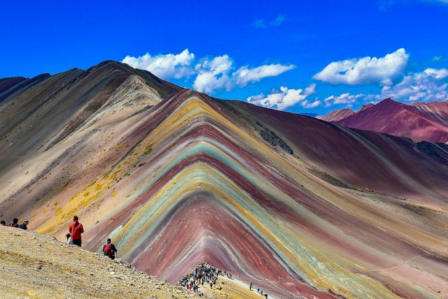 The famous view of the Rainbow Mountains one of the most popular day trips from Cusco of the past 5 years