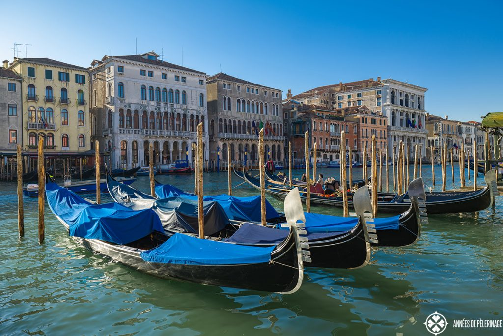 A couple of gondolas along the grand canal in venice, italy