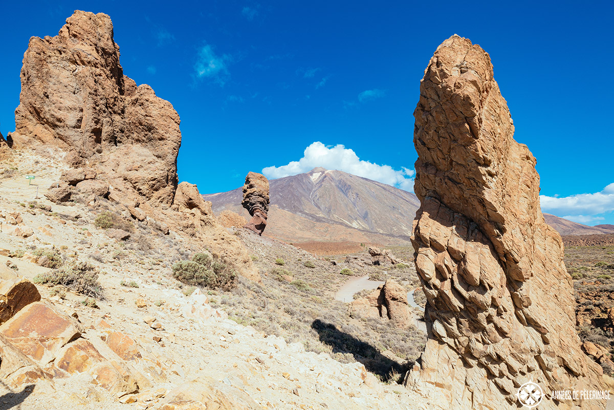 teide volcano framed by spectacular rock formations on both sides in the foreground