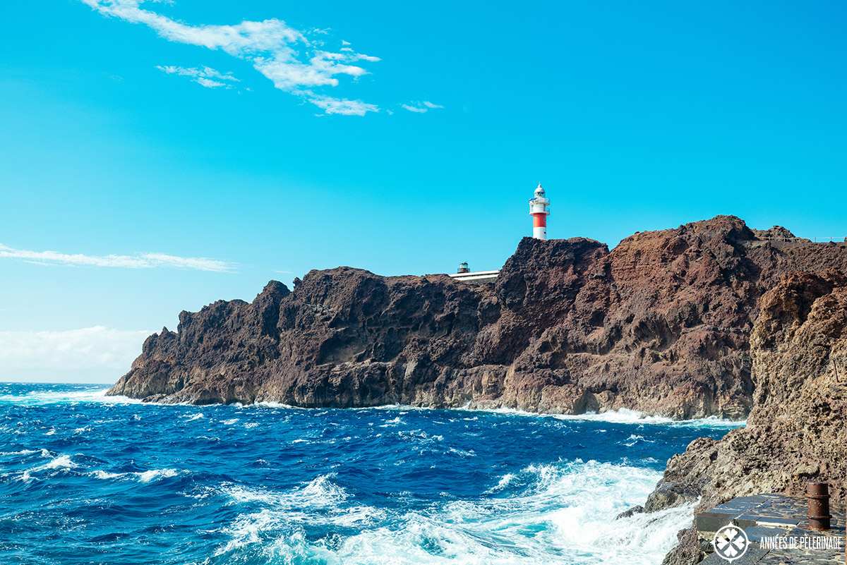 the lighthouse at punta de teno sitting on a cliff made out of volcanic rock